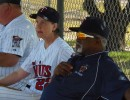 Pitching great and Pro Staff member, Luis Tiant looks on with Annie Breitenbucher during 2012 camp action.