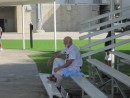 """Made in the Shade"" - Camp Hall of Fame member, Lloyd ""Papa Smurf"" Pallansch, cools off in the shade at Field #5 during 2013 camp action."