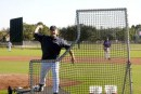 Hall of Fame pitcher and Camp Commissiner, Bert Blyleven toss BP during the 2012 camp instructionals.